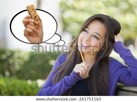 Pensive Woman with Nutritious Snack Bar Inside Thought Bubble. - stock photo