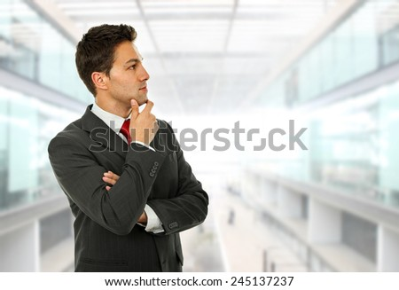 pensive young business man portrait at the office - stock photo