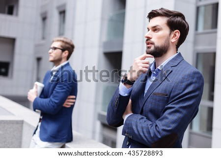 Pensive young colleagues are thinking about project - stock photo