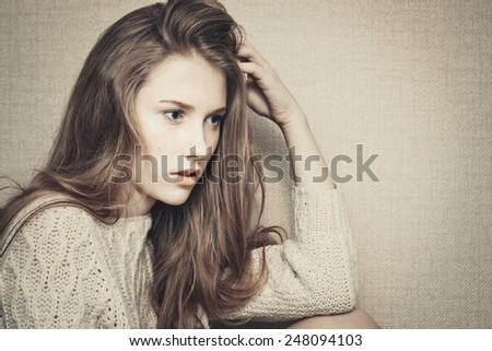 Pensive young girl looking confused about troubles  - stock photo