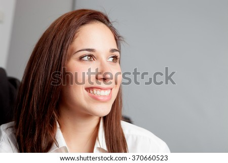 Pensive young girl relaxing at home looking at side - stock photo