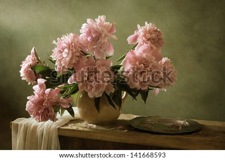Peonies and a tin plate - stock photo