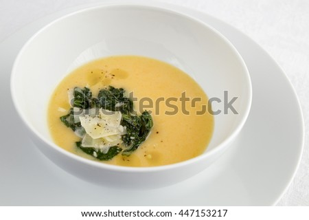 peony of spinach and cheese in pumpkin soup with sour cream - stock photo