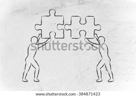 people about to match two pieces of puzzle, metaphor of being close to a solution - stock photo