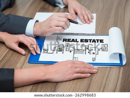 people analyze real estate symbol, close up - stock photo