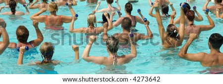 People are doing water aerobic in pool - stock photo