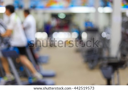 People are exercising in fitness center as blurred background - stock photo