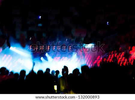 People at a disco at night - stock photo