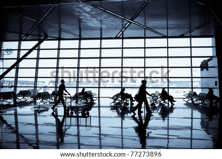 People at a modern airport, departure lounge - stock photo