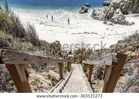 People at Gibson Beach in Point Lobos State Natural Reserve Park, with rock & geological formations along the rugged Big Sur coastline, near Carmel and Monterey, CA. on the California Central Coast. - stock photo