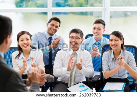 People at lecture applauding to speaker - stock photo