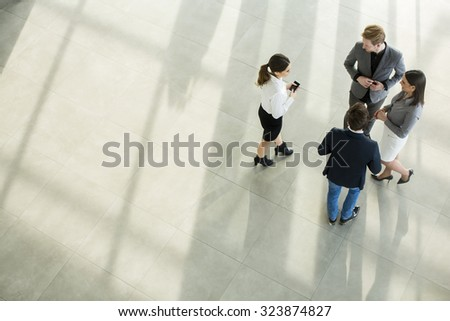 People at the hall in office building - stock photo