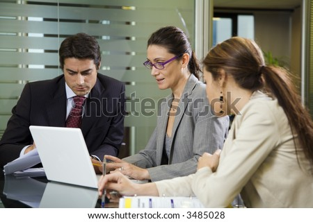 People at work: business team having a meeting - stock photo