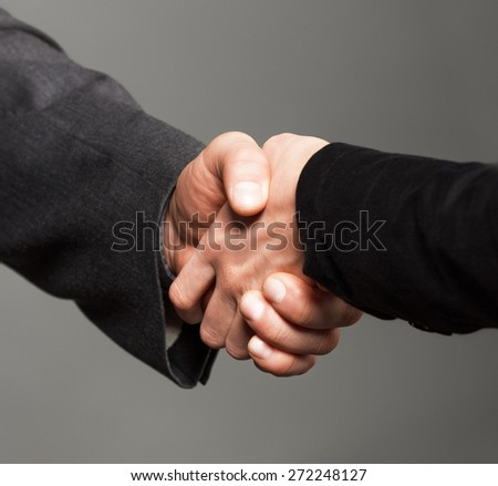 People at work: man and woman hand shaking. - stock photo