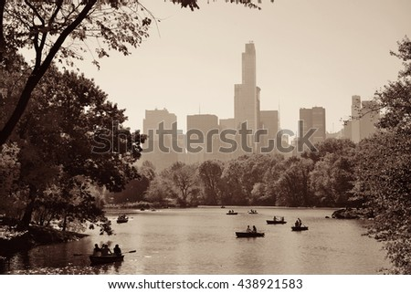 People boating in lake in Central Park in Autumn New York City - stock photo