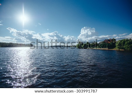 People built houses on the lake. Lovely view of passing yachts - stock photo