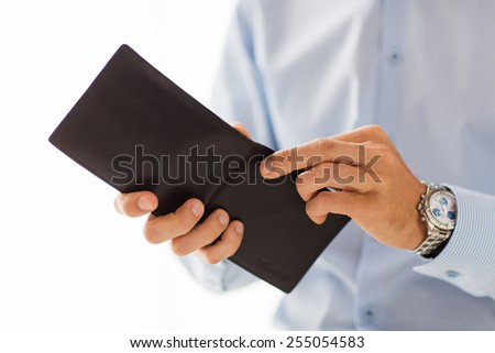 people, business, finances and money concept - close up of businessman hands holding open wallet - stock photo
