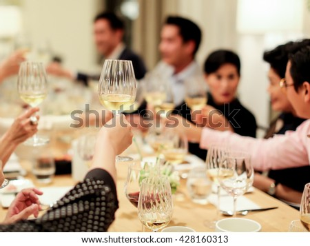 people cheering each other with champagne and wine - stock photo