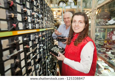 People chooses fasteners in  auto parts store - stock photo