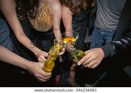 People clinking glasses at the night party, view from above - stock photo