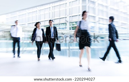 People commuting in Hong Kong. - stock photo
