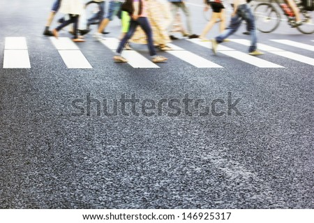 People crossing street, motion blur - stock photo