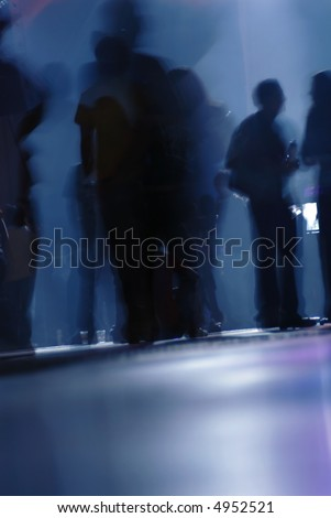 people dancing and listening at a tecno music concert - stock photo