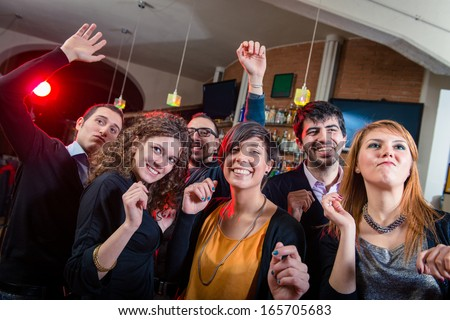 People dancing on a disco pub - Stock Image - stock photo