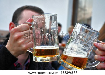 people drinking a beer in a pub - stock photo