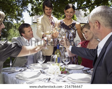 People drinking wine. - stock photo