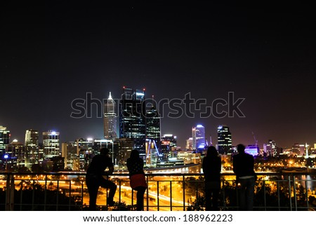 People enjoin view of Perth at night. - stock photo