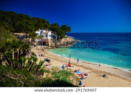 people enjoying the sun on the Cala Gat beach, Majorca, Spain - stock photo