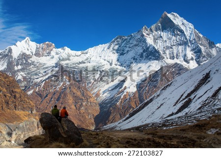 People enjoying view of Machhapuchchhre mountain - Fish Tail in English is a mountain in the Annapurna Himalya, Nepal - stock photo