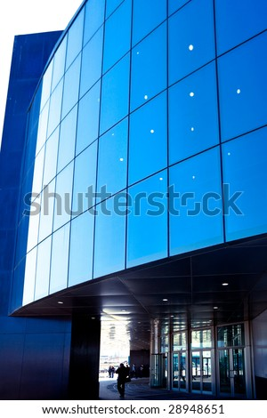 People enter to modern blue office - stock photo
