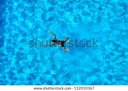 People exercising in a swimming pool - stock photo