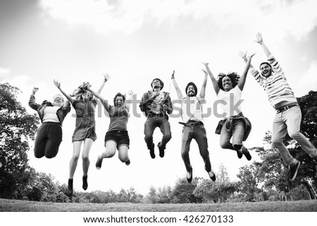 People Friendship Celebration Arms Outstretched Jumping Concept - stock photo