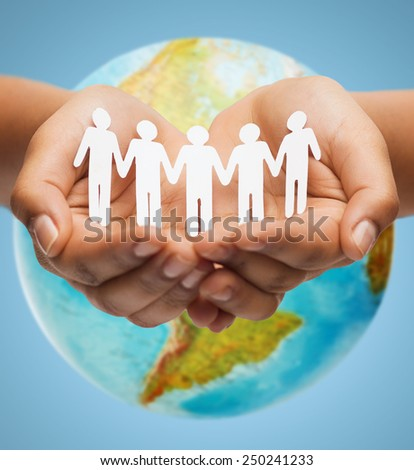 people, geography, population and peace concept - close up of human hands with earth globe showing american continent over blue background - stock photo