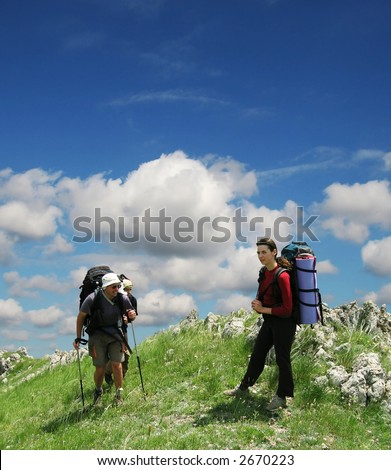 People going ap in Crimea mountain - stock photo
