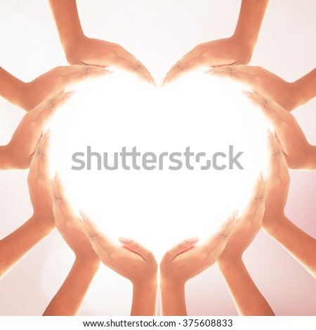 People hands heart shape. Unity Happy Mental Dignity Pray CSR Crowd Art Humility Belief Helpful Trust Peace Many Team Nurses Human Right Touch White Nature Bless Worldwide Science Education Solidarity - stock photo
