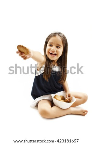People, happy childhood, food, sweets and bakery concept - smiling little girl holding a  bowl  with cookie or biscuit. Isolated on white background - stock photo