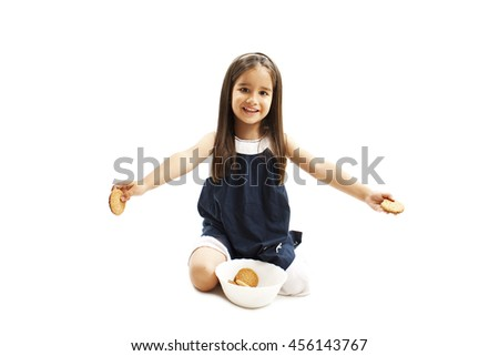People, happy childhood, food, sweets and bakery concept - smiling little girl holding a cookie or biscuit. Isolated on white background  - stock photo