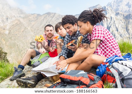 People Having a Rest at top of Mountain - stock photo