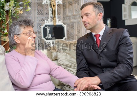 people having conversation in the funeral home - stock photo