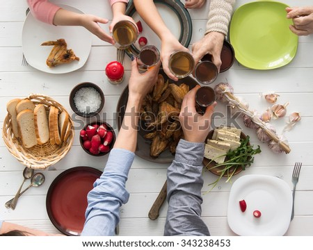 people having meal and clinking glasses top view - stock photo