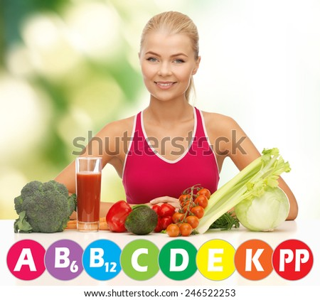 people, healthy eating, vegetarian and health care concept - happy woman with organic food and vitamins over green background - stock photo