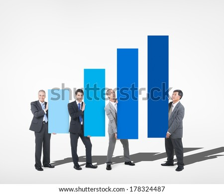 People Holding pillars of Growth Chart - stock photo