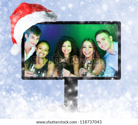 People  holding the glasses of champagne on a monitor screen - stock photo
