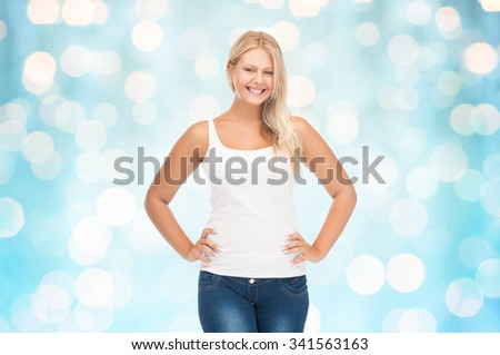 people, holidays, style and body type concept - smiling young woman in blank white shirt and jeans over blue holidays lights background - stock photo