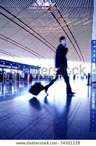 People hurrying in airport. - stock photo
