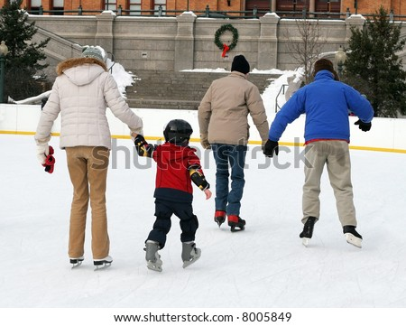 people ice skating - stock photo